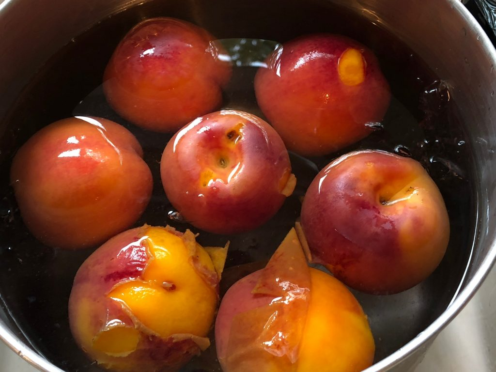 nectarines in ice bath for blanching